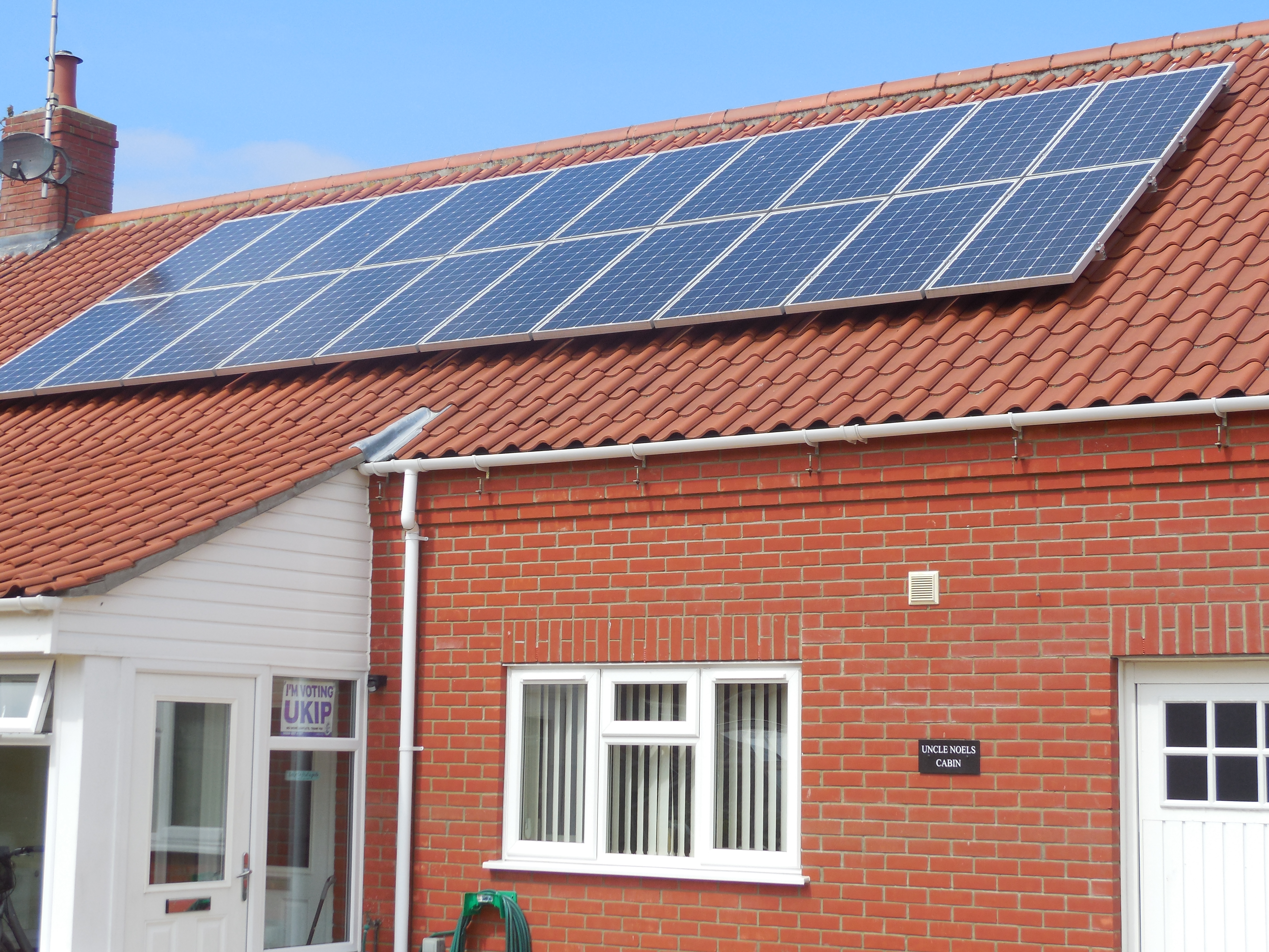 Norfolk bungalow with large solar array and I'm Voting UKIP poster